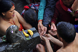 April 26, 2017 - Kathmandu, NP, Nepal - Devotees taking ritual holy bath during the Mother's Day to perform puja at Matatritha temple in Kathmandu, Nepal on Wednesday, April 26, 2017. Mother's day or Matatritha Aunshi is celebrated on Baishak Krishna Ausi according to Lunar calendar. On this auspicious day, people pay homage to their mothers giving her gifts and foods including sweets and fruits. Those who have already lost his/her mother visit Matatritha Temple. People take holy dip on the sacred pond at Mata Tirtha. They also perform different  rituals and praying during this day. (Credit Image: © Narayan Maharjan/NurPhoto via ZUMA Press)