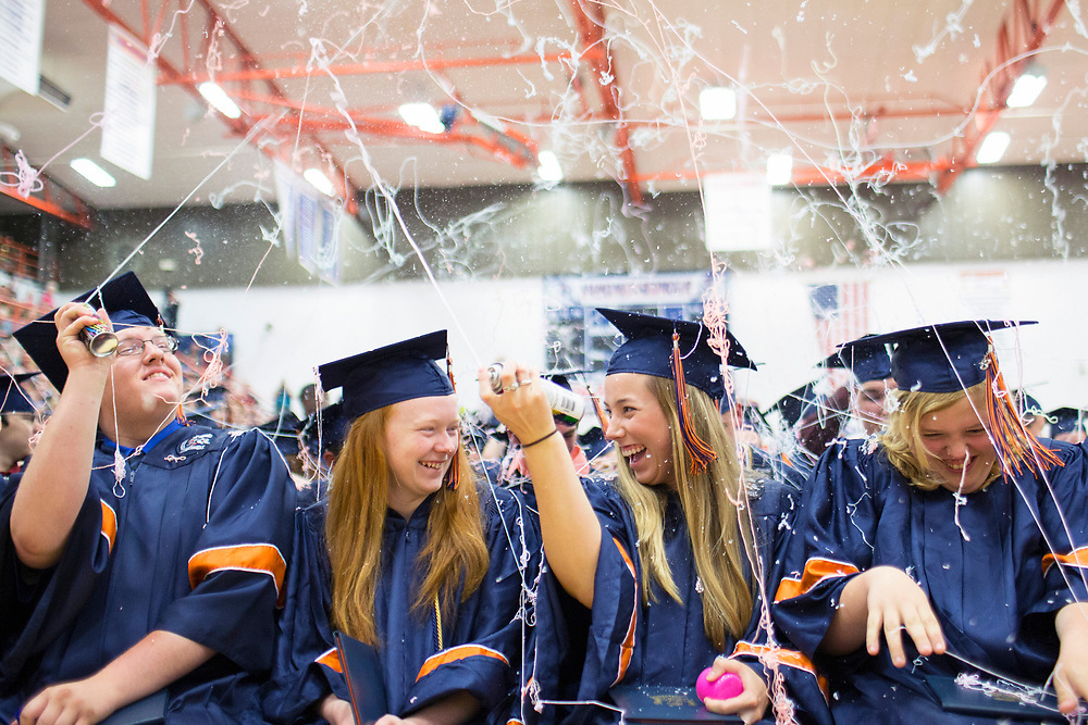 Stephen Haas/ For the News-Gazette<br /> Graduates spray silly string into the air during commencement ceremonies at Mahomet-Seymour High School Sunday, May 26, 2013 in Mahomet, Ill.