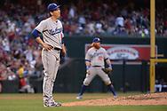 Apr 22, 2017; Phoenix, AZ, USA; Los Angeles Dodgers starting pitcher Kenta Maeda (18) reacts after giving up a home run to the Arizona Diamondbacks in the fourth inning at Chase Field. Mandatory Credit: Jennifer Stewart-USA TODAY Sports