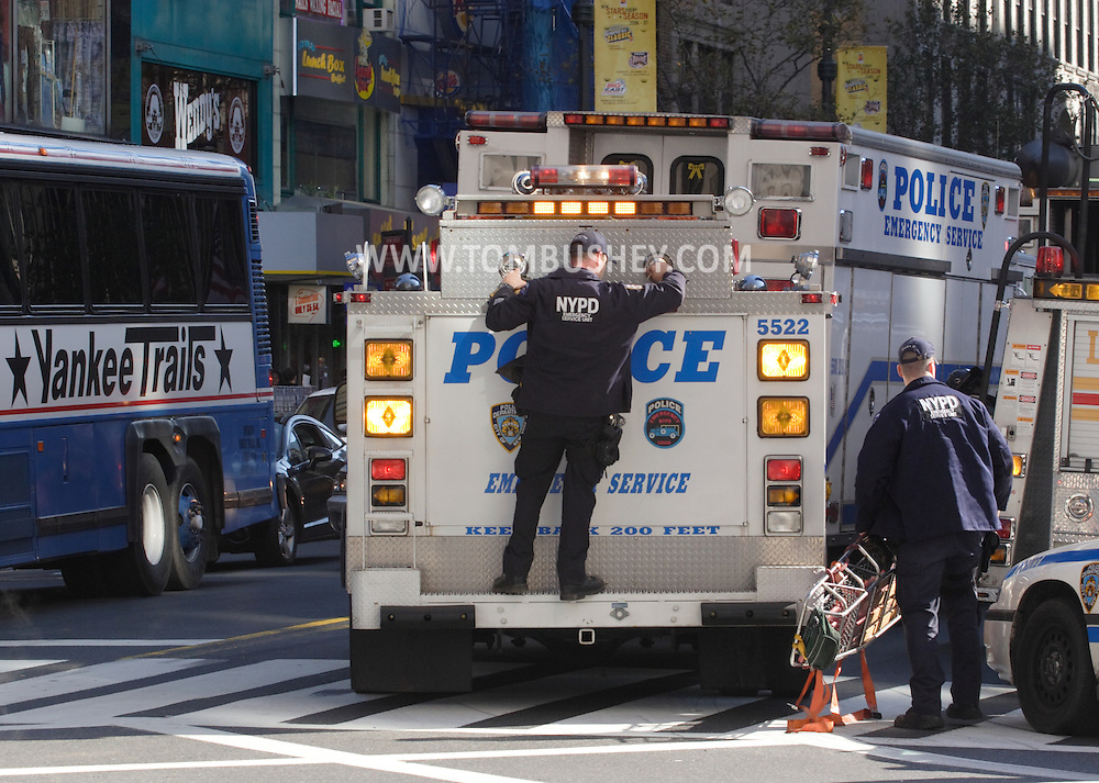 New York, N.Y. - Two members of a New York Police Department Emergency Service Unit respond to a call in Manhattan on Nov. 4, 2006.<br />
