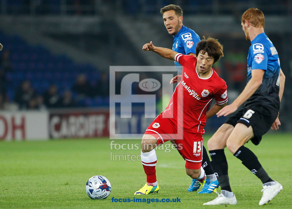 Kim Bo-Kyung of Cardiff City and Shaun Macdonald of Bournemouth during the Sky Bet Championship match at the Cardiff City Stadium, Cardiff<br /> Picture by Mike  Griffiths/Focus Images Ltd +44 7766 223933<br /> 23/09/2014