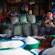Stall holder with produce at Luang Prabang morning market