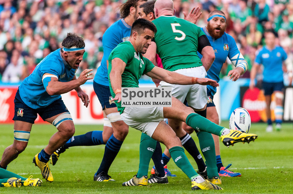 Conor Murray of Ireland box kicks under pressure. Action from the Ireland v Italy pool game at the 2015 Rugby World Cup at Queen Elizabeth Stadium in London, 4 October 2015. (c) Paul J Roberts / Sportpix.org.uk
