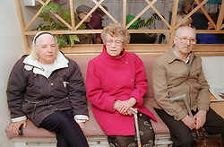 Three women sitting in doctor's waiting room,
