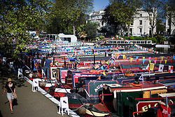 © Licensed to London News Pictures. 06/05/2018. London, UK. Boats covered in bunting at day two of the Canalway Cavalcade festival takes place in Little Venice, West London on Sunday,  May 6th 2018. Inland Waterways Association's annual gathering of canal boats brings around 130 decorated boats together in Little Venice's canals on May bank holiday weekend. Photo credit: Ben Cawthra/LNP