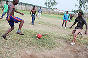 A group of Ugandan men play soccer after a long work day in Juba, South Sudan.  Over 50,000 Kenyans and Ugandans have immigrated to South Sudan over the past couple of years because there are so many job opportunities -- but these families all live together in the same village compound because they're so frequently threatened by the locals, who resent their presence.