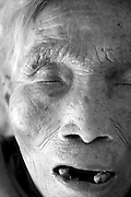 China's Aging Population 3 - An elderly woman sleeps at the hospice.