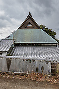 Oiso, Kanagawa prefecture, Japan, February 10 2017 - Keiji and Atsuko Suzuki's minka, traditional wooden house, is the last minka home in Oiso. The previous owner of the 3,000 sq. ft. house moved it from the shores of Lake Biwa, near Kyoto, 35 years ago.<br /> Exterior view from the street.