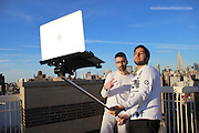 Apple fans use MACBOOK selfie sticks to snap pictures on the go - and the worst part is the people around them don't bat an eyelid<br /> <br /> Prepare for a major eye-roll: Three imaginative young men in New York have dreamed up — and created — an industrial-strength selfie stick, big enough to support an entire laptop.<br /> The Macbook Selfie Stick functions just like a smartphone selfie stick — except that it can fit a full-size Macbook computer in its grips.<br /> And while the invention will likely seem ridiculous to many, it's worth noting that so did the original selfie stick, once upon a time — and now the tech accessory has become so ubiquitous that theme parks and museums have been driven to ban them. <br /> <br /> However, early adopters can't exactly buy the photo-taking tool just yet — and in fact, there only seems to be a single prototype.<br /> Created by artists Moises or Art404, John Yuyi, and Tom Galle, the Macbook Selfie Stick is, at this stage, still just an art project.<br /> But while the trio may be trying to make some sort of statement about society — that our culture is too selfie-obsessed, self-obsessed, or tech-obsessed — it's quite possible that their plan will backfire. <br /> <br /> In a series of images posted online, the group and a few volunteers can be seen using the Macbook Selfie Stick out and about in Manhattan.<br /> They pose for pictures, their laptops held out on a pole several feet in front of them, in places like Times Square and Washington Square Park.<br /> In several of the snaps, crowds of tourists can be seen nearby, and many seem unfazed by the spectacle — sometimes too busy taking their own selfies to even notice.<br /> A few, though, look on with bemused expressions — even in Times Square, where strange and never-before-seen scenes are, actually, seen every day. <br /> <br /> Most people are probably quick to write off such a ridiculous idea — after all, carrying around a laptop and hoisting it up for a picture is certainly cumbersome, with or without a selfie stick.<br /> However, not eve