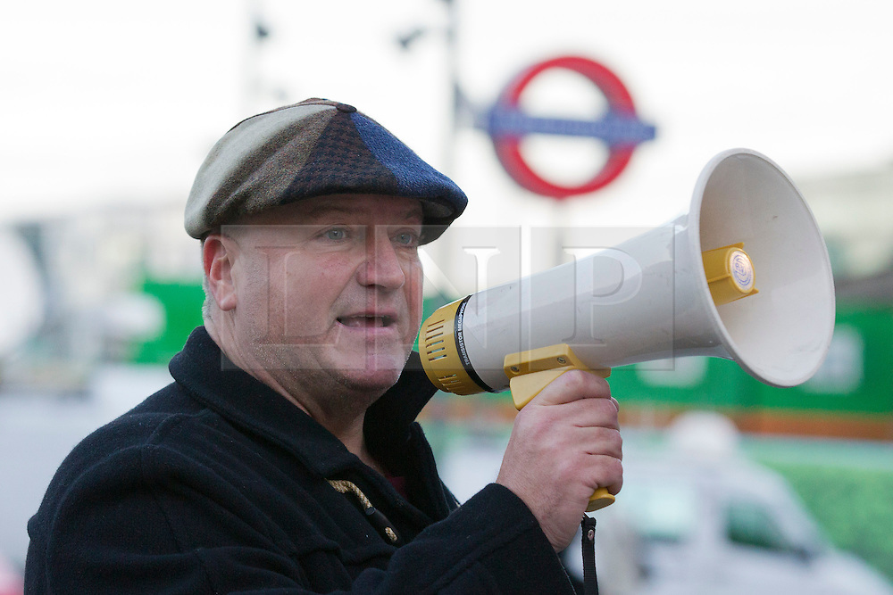 © Licensed to London News Pictures. 11/03/14 RMT union has confined its leader BOB CROW has died today. FILE PICTURE DATED: 02/01/2014. London, UK. RMT Union General Secretary Bob Crow is seen talking to protesters at a demonstration over today's (02/01/2014) 3.1% rail fare rise outside King's Cross Station in London this morning. The rail fare rise came in to force today as most across the country returned to work for the start of 2014. Photo credit: Matt Cetti-Roberts/LNP