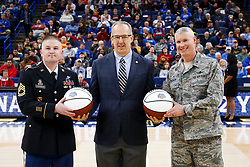 ST. LOUIS, Mo., -- SEC Commissioner Greg Sankey, center, delivered the game ball before Game 01 of the 2018 SEC Men's Basketball Tournament, Wednesday, March 07, 2018 at the Scott Trade Center in ST. LOUIS.