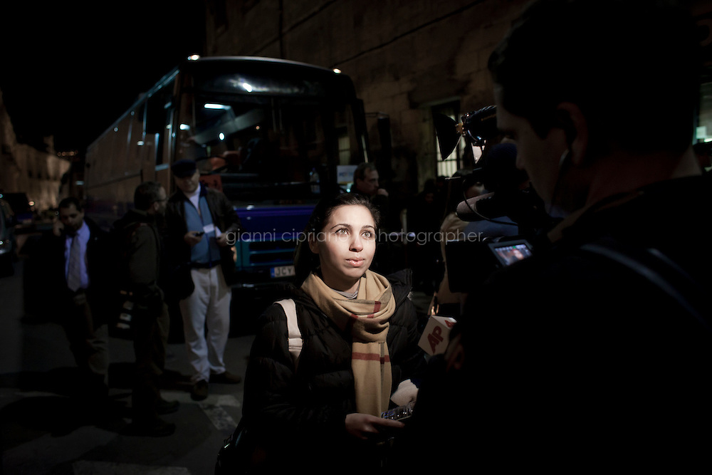 25 February 2011. Valletta, Malta. People evacuated from Libya are transferred to the hotels upon their arrival in Malta. A U.S.-chartered ferry evacuated Americans and other foreigners out of Libya on Friday and brought them to the Mediterranean island of Malta. The Maria Dolores ferry, after three days of delays, brought over 300 passengers, including at 167 U.S. citizens, away from Libya where Colonel Gaddafi's forces continue to clash with anti-government demonstrators.<br /> <br /> <br /> &copy;2011 Gianni Cipriano<br /> cell. +1 646 465 2168 (USA)<br /> cell. +39 328 567 7923<br /> gianni@giannicipriano.com<br /> www.giannicipriano.com