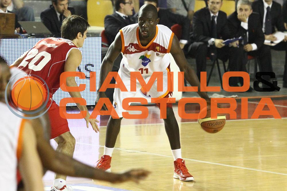DESCRIZIONE : Roma Lega A 2012-13 Virtus Roma Trenkwalder Reggio Emilia<br /> GIOCATORE : Dagunduro Adeola<br /> CATEGORIA : palleggio<br /> SQUADRA : Virtus Roma<br /> EVENTO : Campionato Lega A 2012-2013 <br /> GARA : Virtus Roma Trenkwalder Reggio Emilia<br /> DATA : 14/10/2012<br /> SPORT : Pallacanestro <br /> AUTORE : Agenzia Ciamillo-Castoria/M.Simoni<br /> Galleria : Lega Basket A 2012-2013  <br /> Fotonotizia : Roma Lega A 2012-13 Virtus Roma Trenkwalder Reggio Emilia<br /> Predefinita :