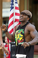 Middletown, New York - Damola from Studio Ayo Fitness participates in Zumba in the Street during the 2012 Run 4 Downtown road race on Saturday, Aug. 18, 2012.