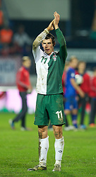 OSIJEK, CROATIA - Tuesday, October 16, 2012: Wales' Gareth Bale applauds the travelling supporters after his side's 2-0 defeat by Croatia during the Brazil 2014 FIFA World Cup Qualifying Group A match at the Stadion Gradski Vrt. (Pic by David Rawcliffe/Propaganda)