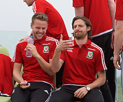 DINARD, FRANCE - Tuesday, June 7, 2016: Wales' Joe Allen jokes with Chris Gunter as players prepare for a team group photograph at the Novotel Thalasso Dinard ahead of the start of the UEFA Euro 2016 tournament. (Pic by Paul Greenwood/Propaganda)
