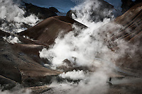 A man hiking in the Geothermal hills at Kerlingarfjöll Mountain Range, Interior of Iceland.
