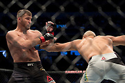 DALLAS, TX - MAY 13:  Junior dos Santos connects with a punch against Stipe Miocic during UFC 211 at the American Airlines Center on May 13, 2017 in Dallas, Texas. (Photo by Cooper Neill/Zuffa LLC/Zuffa LLC via Getty Images) *** Local Caption *** Junior dos Santos; Stipe Miocic