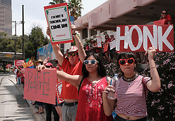 April 26, 2018 - Tucson, Arizona, U.S - Tucson teachers walkout of classes to demand pay increases and added funding to education. Tens of thousands of Arizona teachers voted to go on strike rejecting the offer of Governor Ducey. The teachers union insist the plan to increase teacher salaries by 20% by 2020 was unsustainable and offered no increases to school funding which were cut by 1 bilion dollars after the recession. Public schools districts throughout Arizona decided to close the schools at least until the end of this week. (Credit Image: © Christopher Brown via ZUMA Wire)