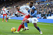 Charlton Athletic defender Tareiq Holmes-Dennis clears from Birmingham City midfielder Jacques Maghoma during the Sky Bet Championship match between Birmingham City and Charlton Athletic at St Andrews, Birmingham, England on 21 November 2015. Photo by Alan Franklin.