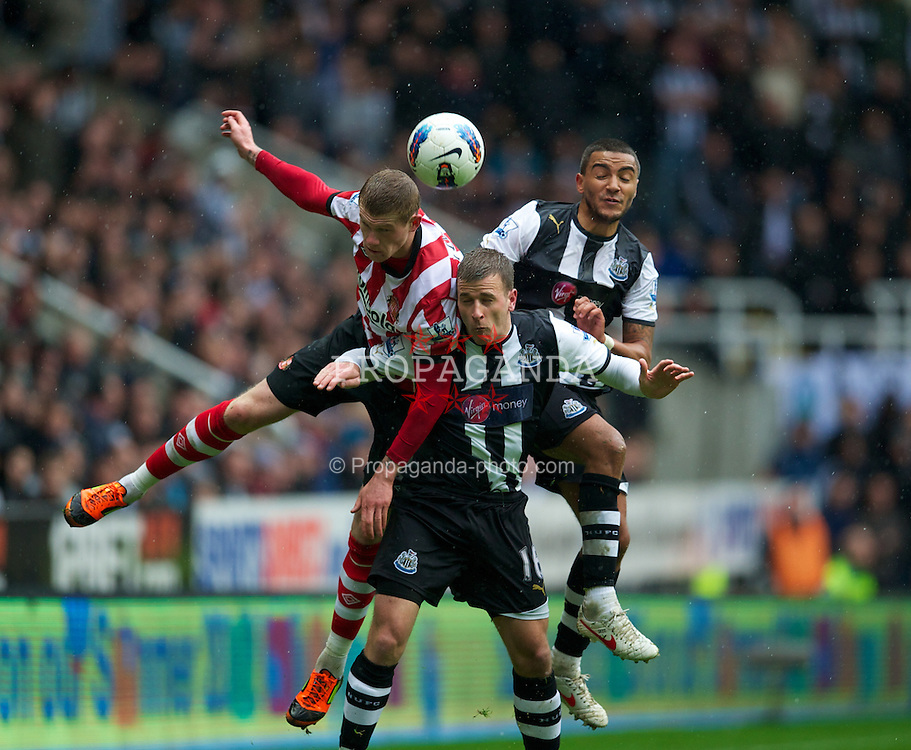 NEWCASTLE, ENGLAND - Sunday, March 4, 2012: Newcastle United's Ryan Taylor and Danny Simpson challenge Sunderland's James McLean during the Premiership match at St. James' Park. (Pic by David Rawcliffe/Propaganda)