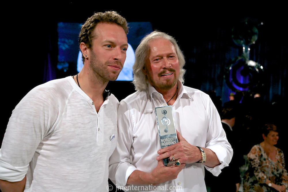 (L-R) Chris Martin (Coldplay), Barry Gibb. The Silver Clef Lunch 2013 in aid of  Nordoff Robbins held at the London Hilton, Park Lane, London.<br /> Friday, June 28, 2013 (Photo/John Marshall JME)