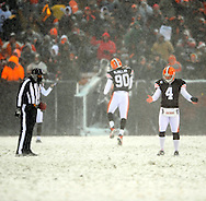 Kicker Phil Dawson can't find the yard line to place the ball before a kickoff..The Cleveland Browns continued their playoff hunt with an 8-0 win over visiting Buffalo.  .Photo by David  Richard