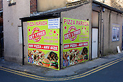 Pizza business advertising on a street corner in Harrogate, North Yorkshire.