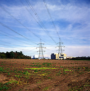 Pylons carrying high voltage electricity cables cross countryside from Sizewell nuclear power station