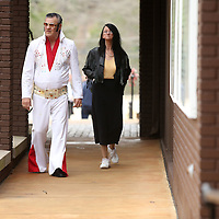 Adam Robison | BUY AT PHOTOS.DJOURNAL.COM<br /> Ray Jumper, from New Albany, an Elvis Look-Alike, walks with Barbara Hollands, also of New Albany, on their way into the Elvis Presley Birthplace for the 81st birthday party for Elvis Friday afternoon in Tupelo.