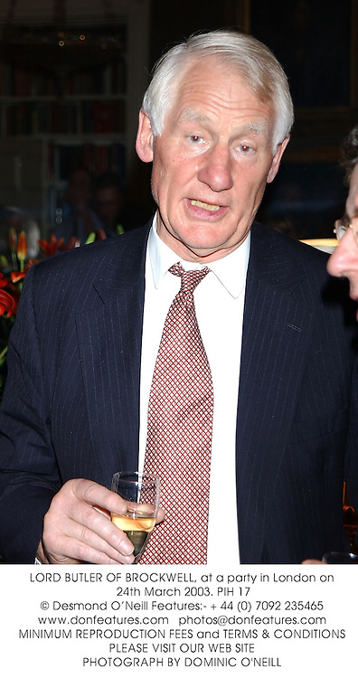 LORD BUTLER OF BROCKWELL, at a party in London on 24th March 2003.PIH 17