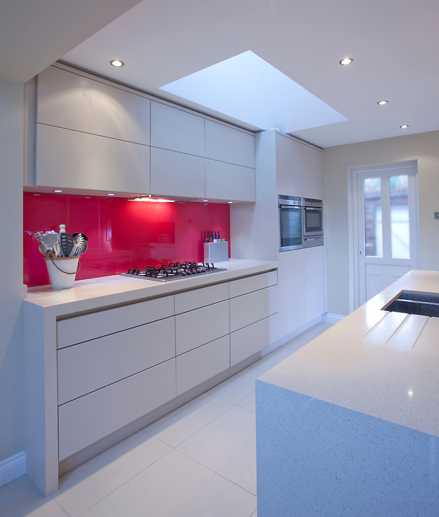 kitchen. white units. red splashback. Kitchen interiors