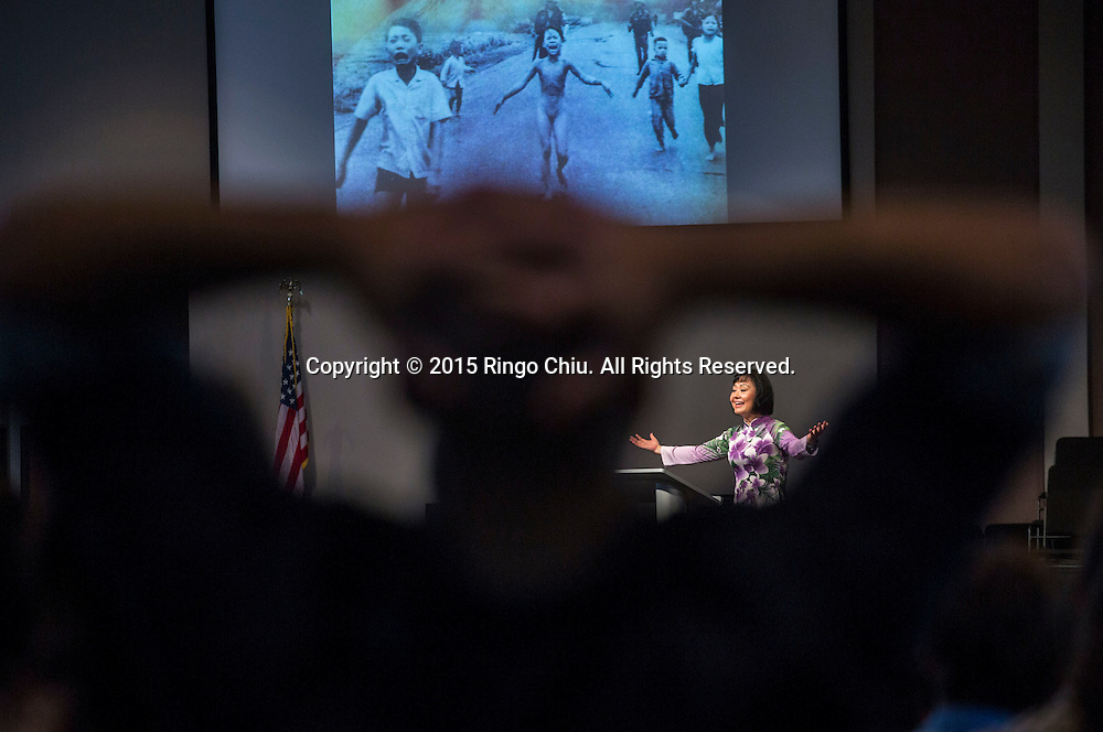Kim Phuc Phan Thi, the subject of a Pulitzer-Prize winning Vietnam War-era photo as a child, Napalm Girl, speaks about her life and the power of forgiveness during the main worship service in Liberty Baptist Church, Newport Beach, California, Sunday, September 13, 2015.