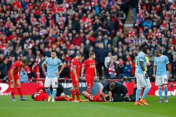 Mamadou Sakho and Emre Can of Liverpool both receive treatment - Mandatory byline: Rogan Thomson/JMP - 28/02/2016 - FOOTBALL - Wembley Stadium - London, England - Liverpool v Manchester City - Capital One Cup Final.