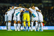 Leeds United huddle during the EFL Sky Bet Championship match between Leeds United and West Bromwich Albion at Elland Road, Leeds, England on 1 October 2019.