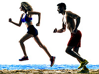one caucasian couple man and woman on the beach runners running silhouette isolated on white background
