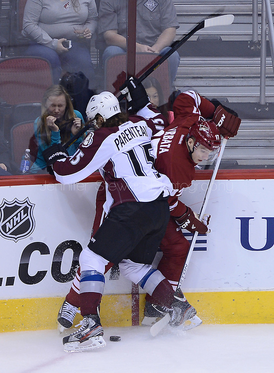 Apr. 6, 2013; Glendale, AZ, USA;  Phoenix Coyotes right wing Radim Vrbata (17) battles for the puck in the first period with the Colorado Avalanche right wing P.A. Parenteau (15) at Jobing.com Arena. Mandatory Credit: Jennifer Stewart-USA TODAY Sports