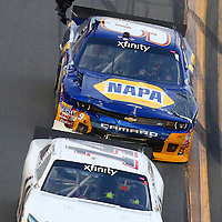 Driver Chase Elliott loses the tape from his hood during the Alert Today Florida 300 XFinity Series race at Daytona International Speedway on Saturday, February 21, 2015 in Daytona Beach, Florida.  (AP Photo/Alex Menendez)