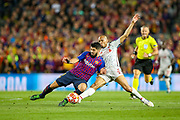 Liverpool midfielder Fabinho (3) tackles Barcelona forward Luis Suárez (9) during the Champions League semi-final leg 1 of 2 match between Barcelona and Liverpool at Camp Nou, Barcelona, Spain on 1 May 2019.