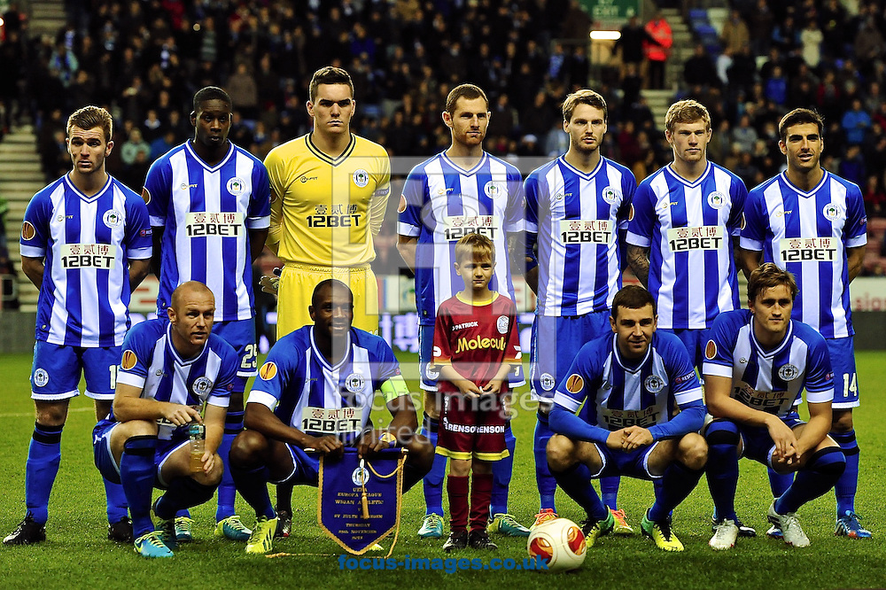 Picture by Ian Wadkins/Focus Images Ltd +44 7877 568959<br /> 28/11/2013<br /> Wigan Athletic players line up ahead of the UEFA Europa League match at the DW Stadium, Wigan.