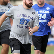 Carolina Panther (USC Alumnus) NFC Pro Bowl starting Center, Ryan Kalil, pull up field on a running play at Hickam Air Base, Honolulu, Hawaii.  Photo by Barry Markowitz, 1/26/12