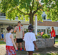 North Merrick, New York, U.S. September 11, 2019. At Park Avenue School students and staff listen to a patriotic song, and then each class with its teacher pauses in front of the 9/11 Memorial Garden garden in front of the entrance, on their way back into the school. Some shook hands or hugged NICHOLAS CARRANO, 15, of Merrick, a member of Boy Scout Troop 123 and student at Mepham High School. Earlier in ceremony, Principal E. Speidel of the K-6 elementary school talked about the significance of 911 and the 9/11 Memorial Garden, on the 18th Anniversary of the terrorist attacks Sept. 11, 2001.