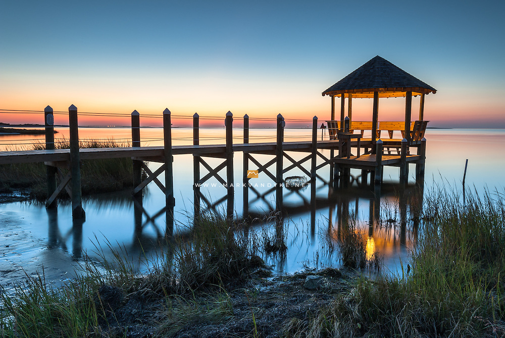 An outdoor coastal gazebo extends the useable living space of this coastal residence out onto the Pamlico Sound.  Located in Hatteras, this outdoor structure is part of the greater chain of barrier islands known as the Outer Banks.  On this particular evening, the Pamlico Sound was glass smooth and the clear conditions provided an extended blue hour as the day transitioned to night.
