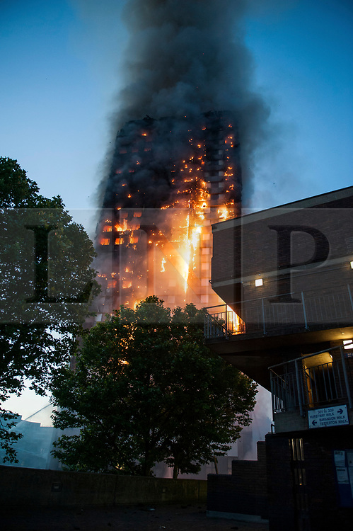 © Licensed to London News Pictures. 14/06/2017. London, UK. The scene of a huge fire at Grenfell tower block in White City, London. The blaze engulfed the 27-storey building with 200 firefighters attending the scene. There were reports of people trapped in the building. Photo credit: Guilhem Baker/LNP