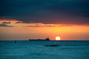 Horizontal image of a tanker at sunset in Hawaii.
