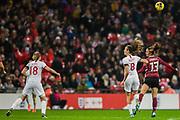 Jill Scott (England) & Sara Ilonka Däbritz (Germany) head the ball away with Ellen White (England) alongside during the International Friendly match between England Women and Germany Women at Wembley Stadium, London, England on 9 November 2019.