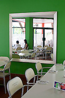 The bright green decor of the Mango Jam Restaurant in Port Douglas, far north Queensland, Australia.