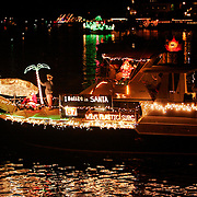 """Ken White's boat themed """" I Belize in Santa"""" participates in the North Carolina Holiday Flotilla at Banks Channel, Wrightsville Beach...Photo by Logan Mock-Bunting"""