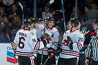 KELOWNA, BC - OCTOBER 20: Henri Jokiharju #16, Joachim Blichfeld #20, Kieffer Bellows #22 and Cody Glass #8 of the Portland Winterhawks celebrate a third period empty net goal against the Kelowna Rockets at Prospera Place on October 20, 2017 in Kelowna, Canada. (Photo by Marissa Baecker/Getty Images)