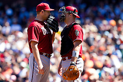 May 30, 2010; San Francisco, CA, USA;  Arizona Diamondbacks relief pitcher Aaron Heilman (22) talks with catcher Chris Snyder (19) during the seventh inning against the San Francisco Giants at AT&T Park.  San Francisco defeated Arizona 6-5 in 10 innings.